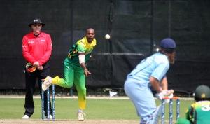 Andrew Mansale bowling for Vanuatu