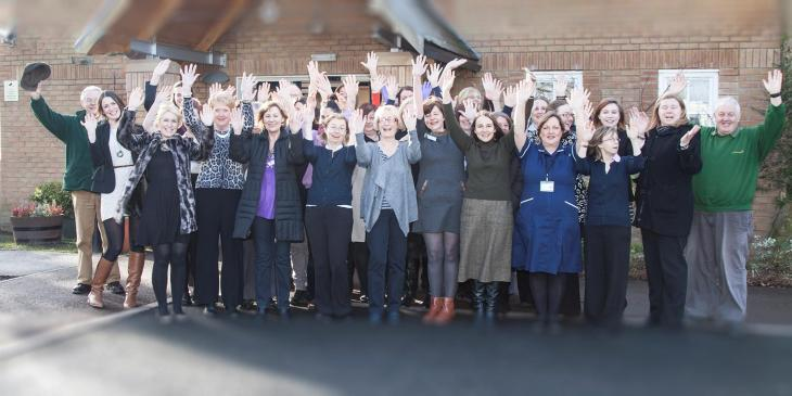 Staff and volunteers at St Cuthbert's hospice celebrate